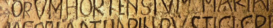 Ancient Latin text written on a large piece of stone.