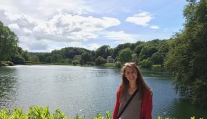 Lily Kobs in front of a lake and Mock Pantheon building in Stourhead, England