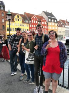 Nick Smith and friends posing on a bridge in Nyhavn, Copenhagen